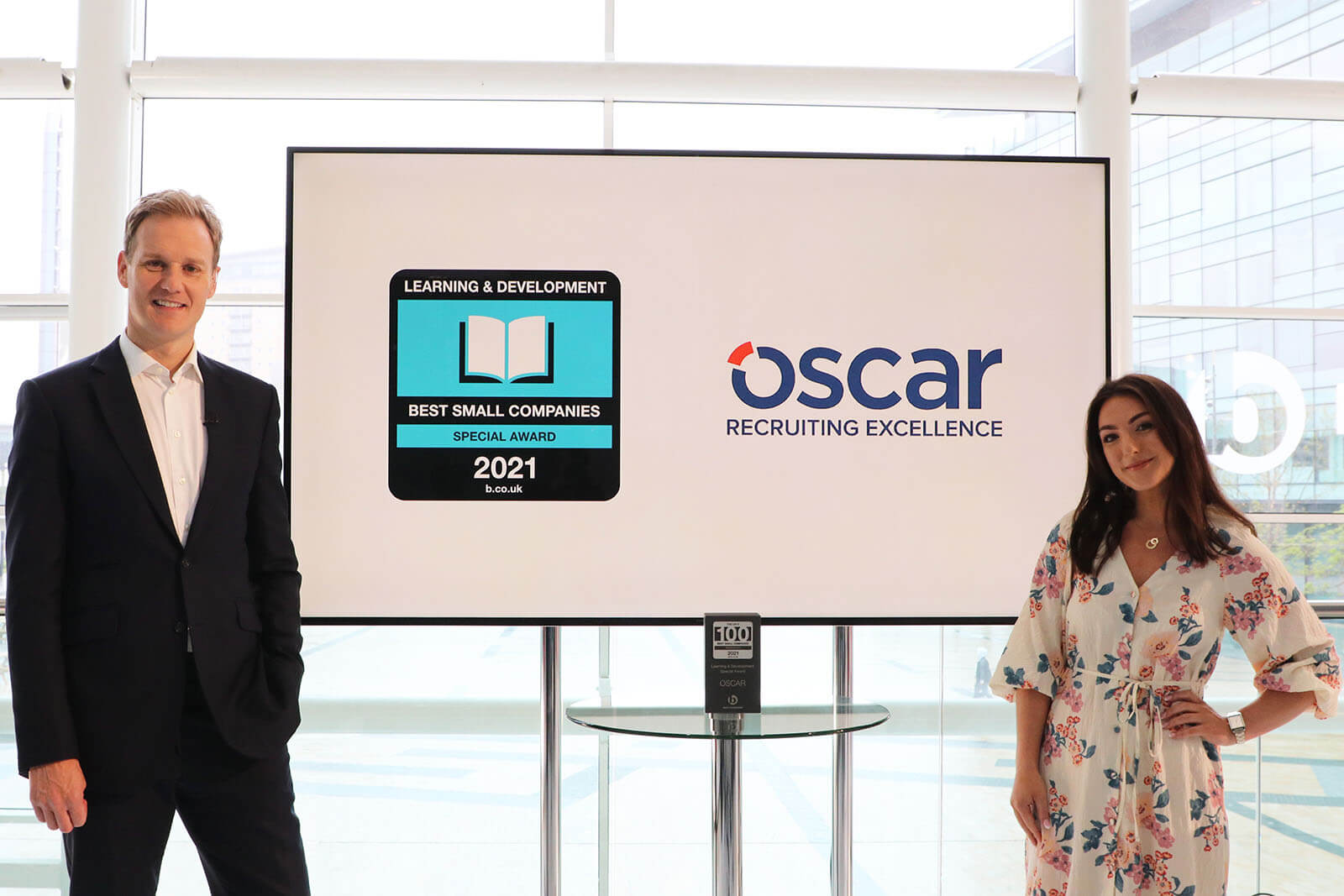 TV presenter Dan Walker with Melanie Sedgley Head of People and Culture at Oscar and the Learning and Development Special Award at Best Companies Live