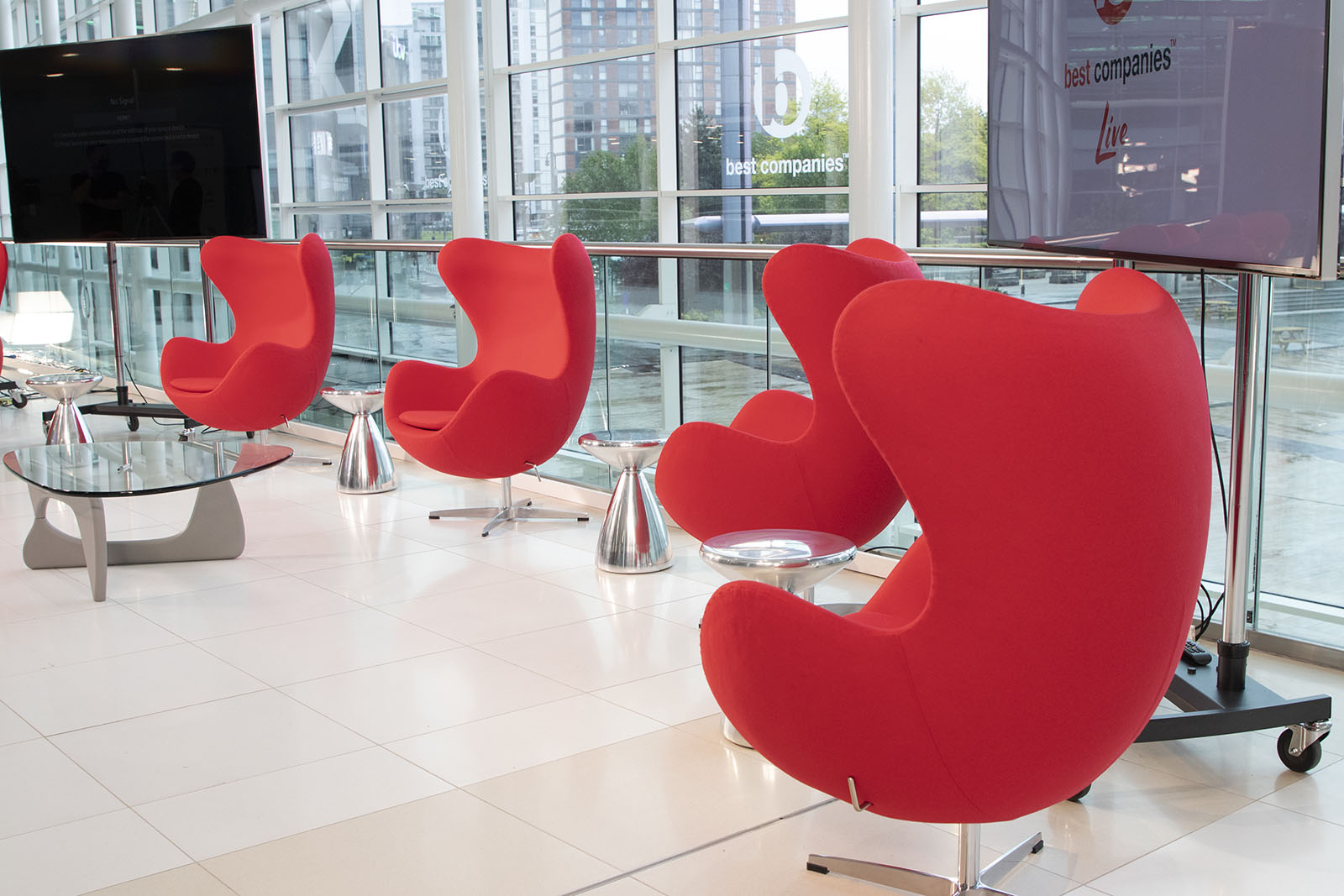 Four red chairs on the set of Best Companies Live at Media City UK