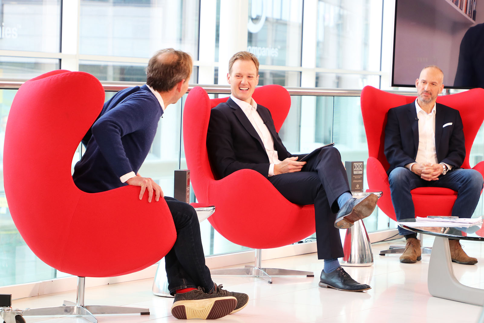 TV Presenter Dan Walker laughing with special Guests Toby Pearson of DTSquared and Edward Perry CEO of COOK Trading