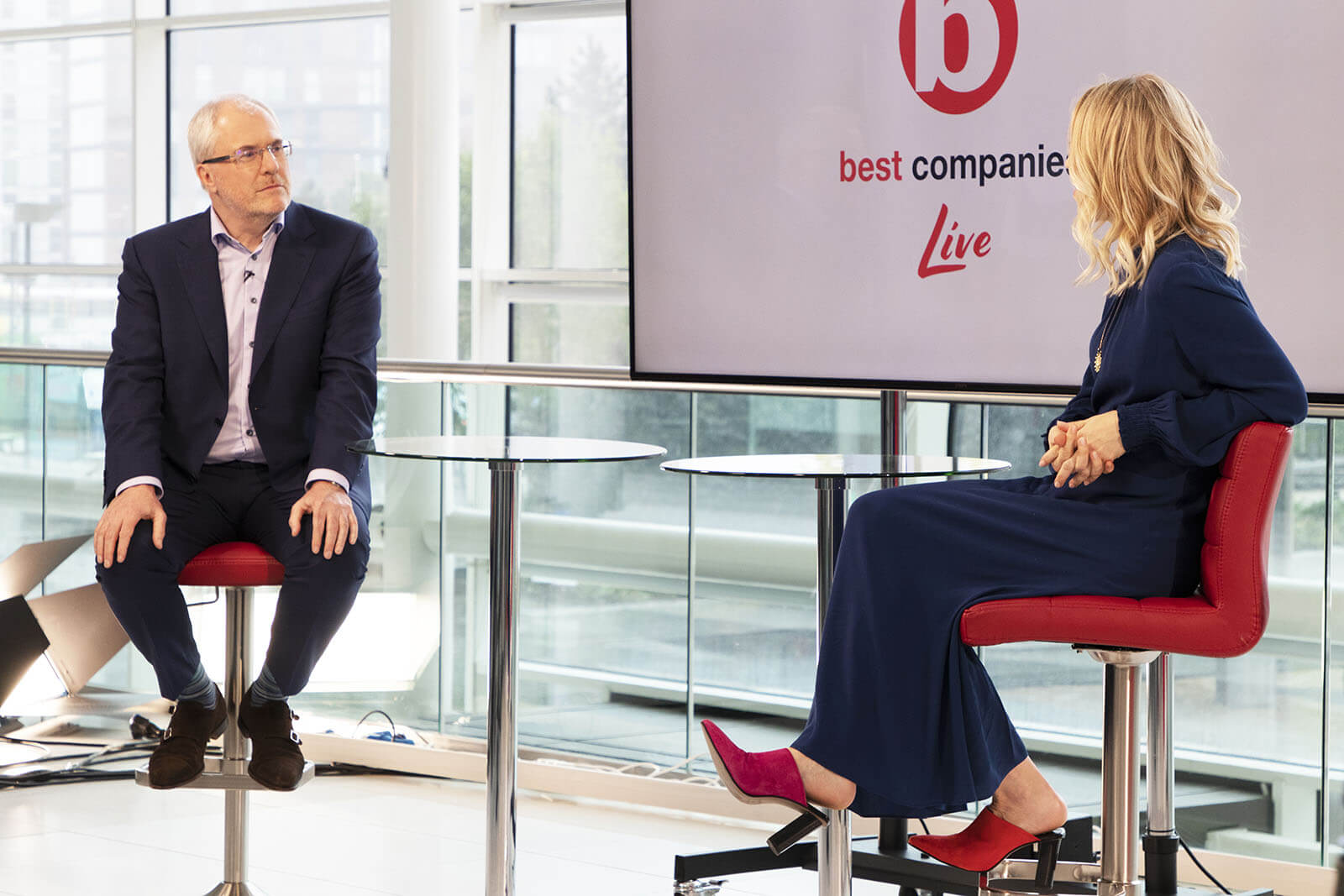 Best Companies CEO Jonathan Austin with presenter and actress Jemma Bolt on the set of Best Companies Live