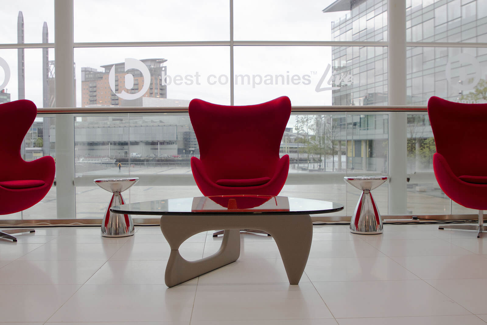 Three red chairs on the set of Best Companies Live at Media City UK