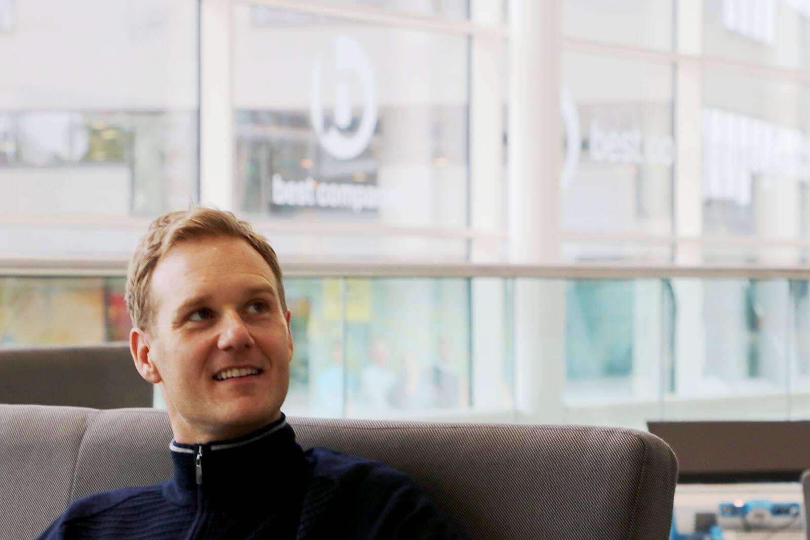 TV Presenter Dan Walker Smiling whilst sat down at Best Companies Live