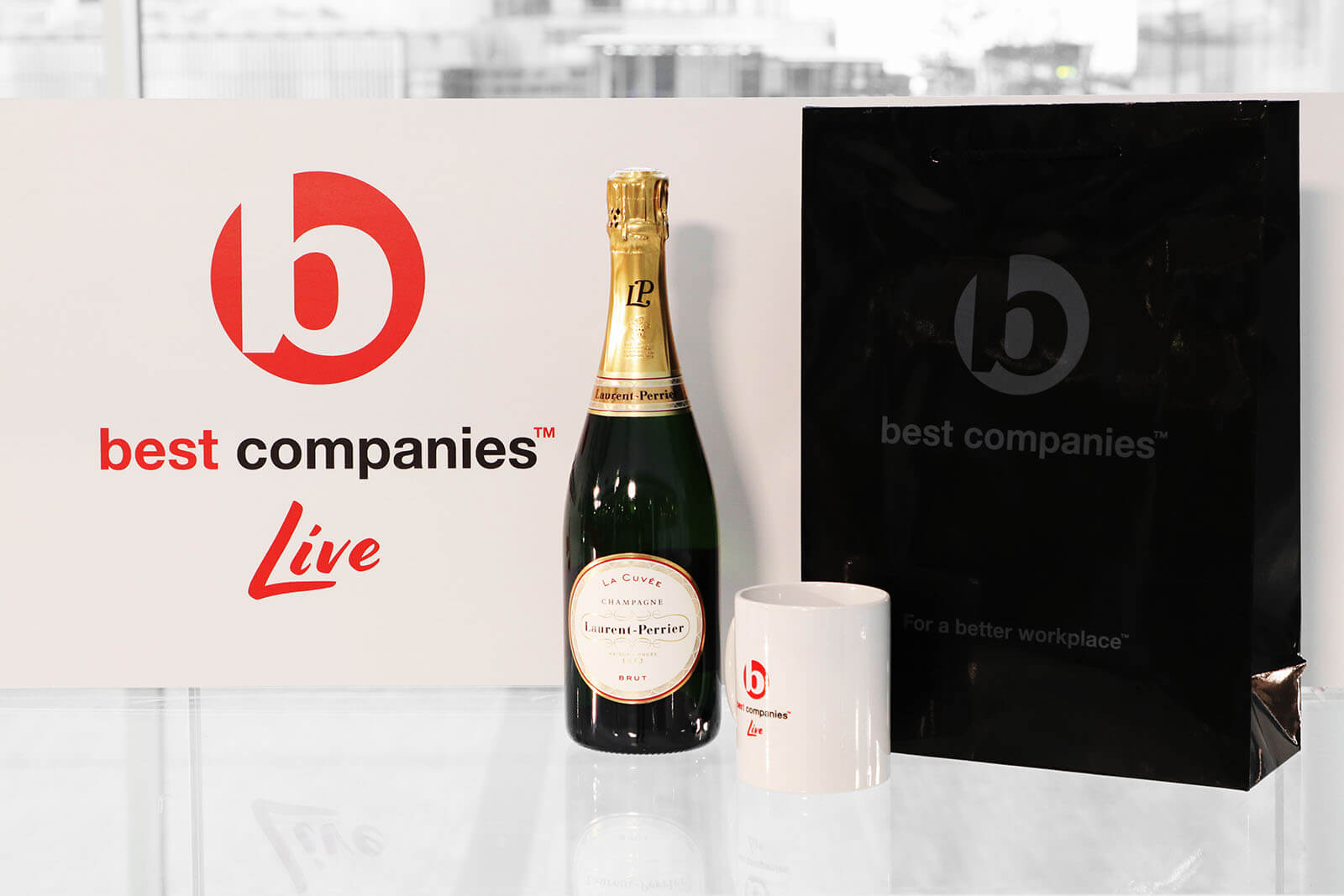 Best Companies Live Logo with Laurent Perrier Champagne and the official Best Companies Live mug