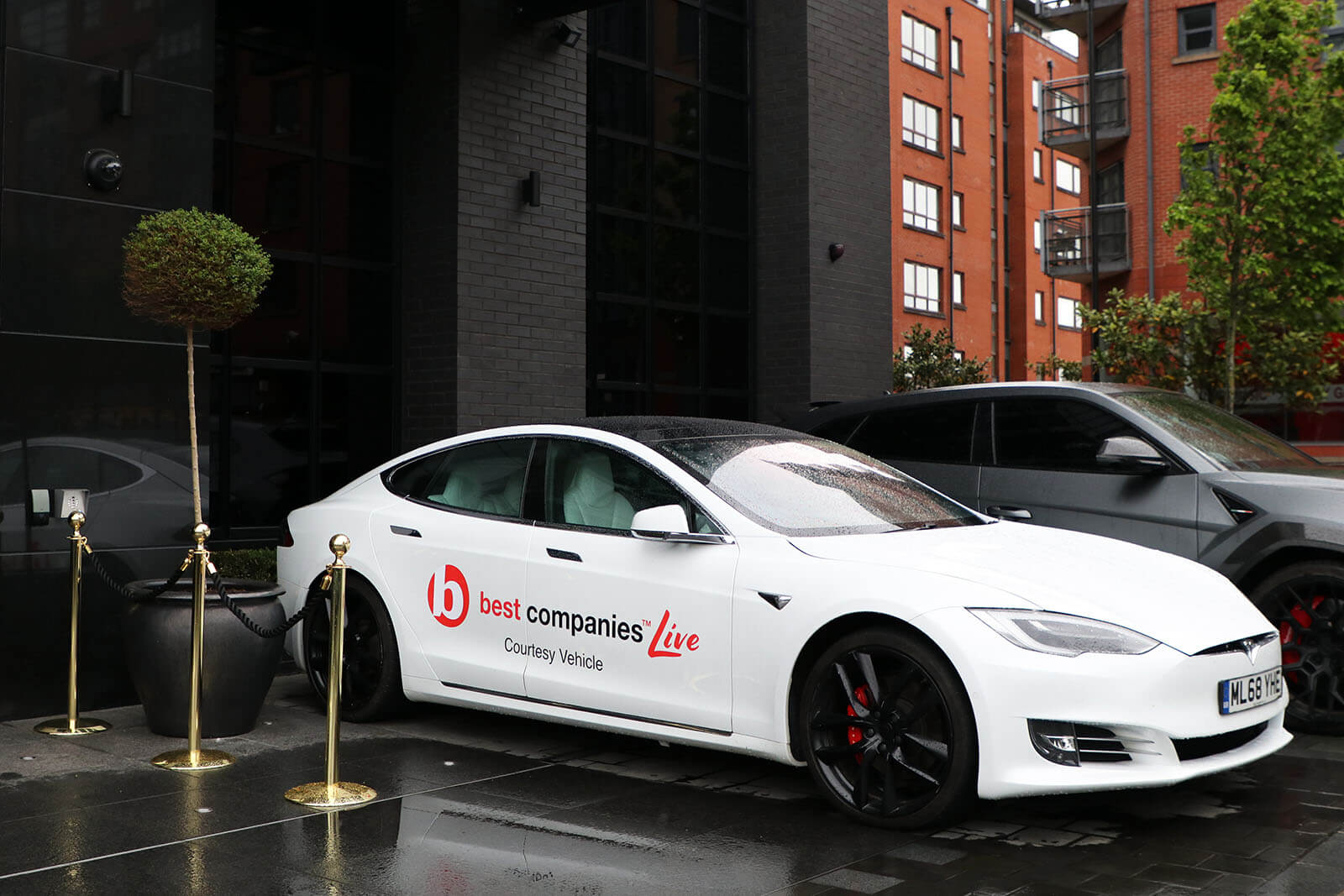 Best Companies Live branded Telsa Curtsey Vehicle
