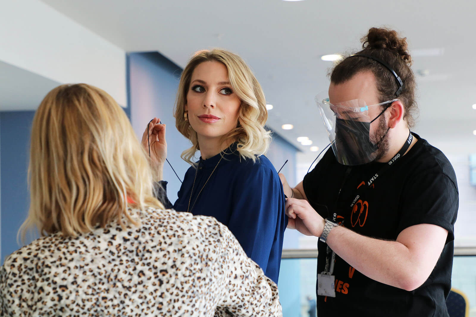 Actress and Presenter Jemma Bolt being mic'd up by two members of the event team at Best Companies Live