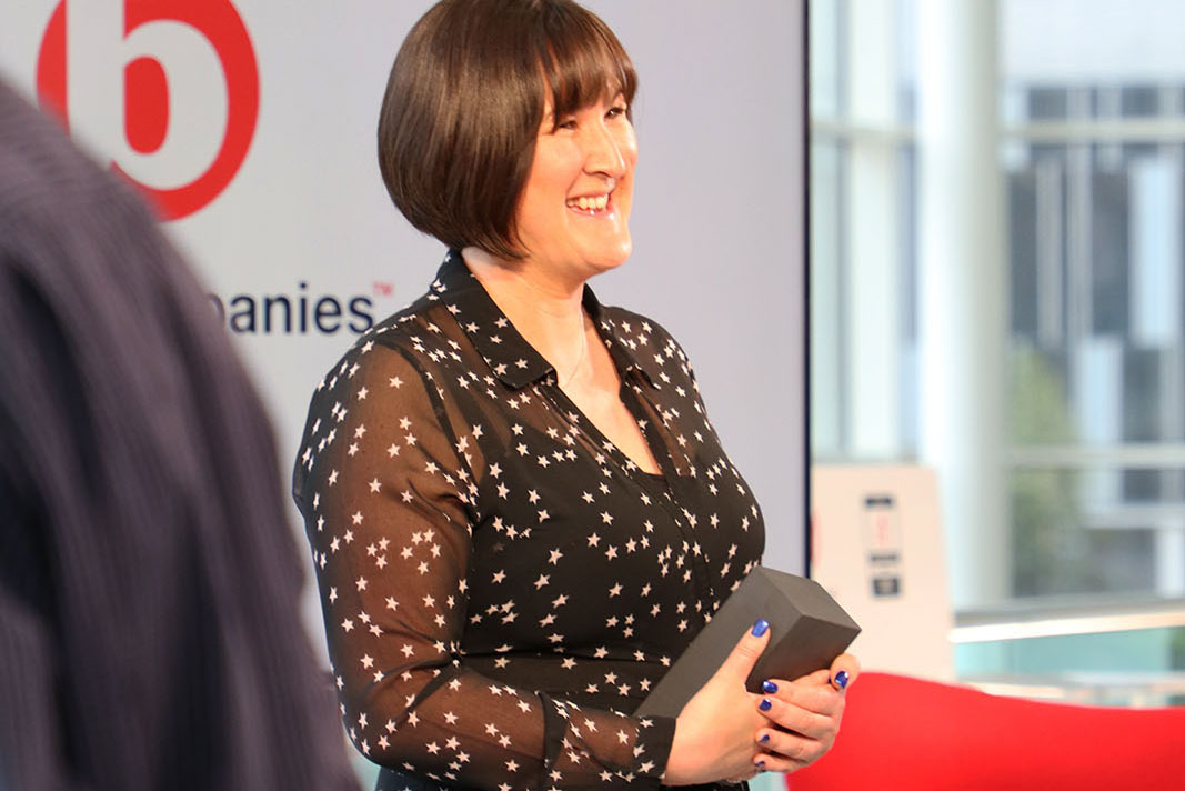 CEO and co-founder of Onefile Susanna Lawson with award on the set of Best Companies Live