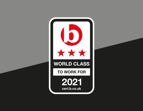 Accreditation logo used on grey and black