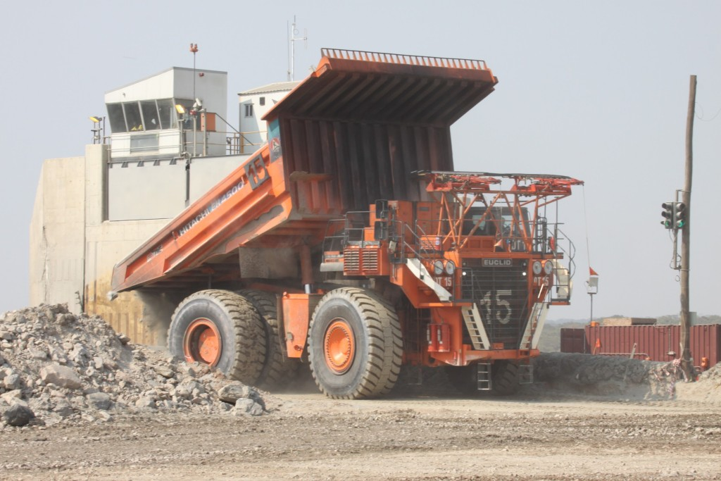 Image of truck dumping in crusher