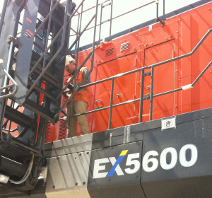 Image of worker on a Hitachi EX5600.