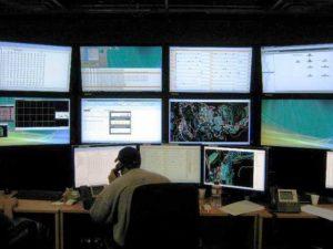 Image of dispatcher using Wenco fleet management system.