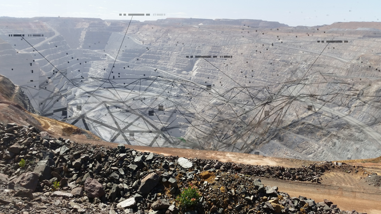 Open pit, connected by data.