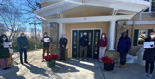 The Knights of Columbus deliver roses to the Woburn Nursing Center.