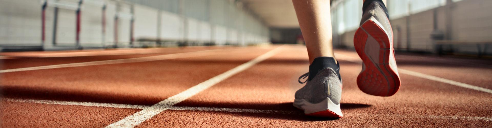 runner's feet representing commitment