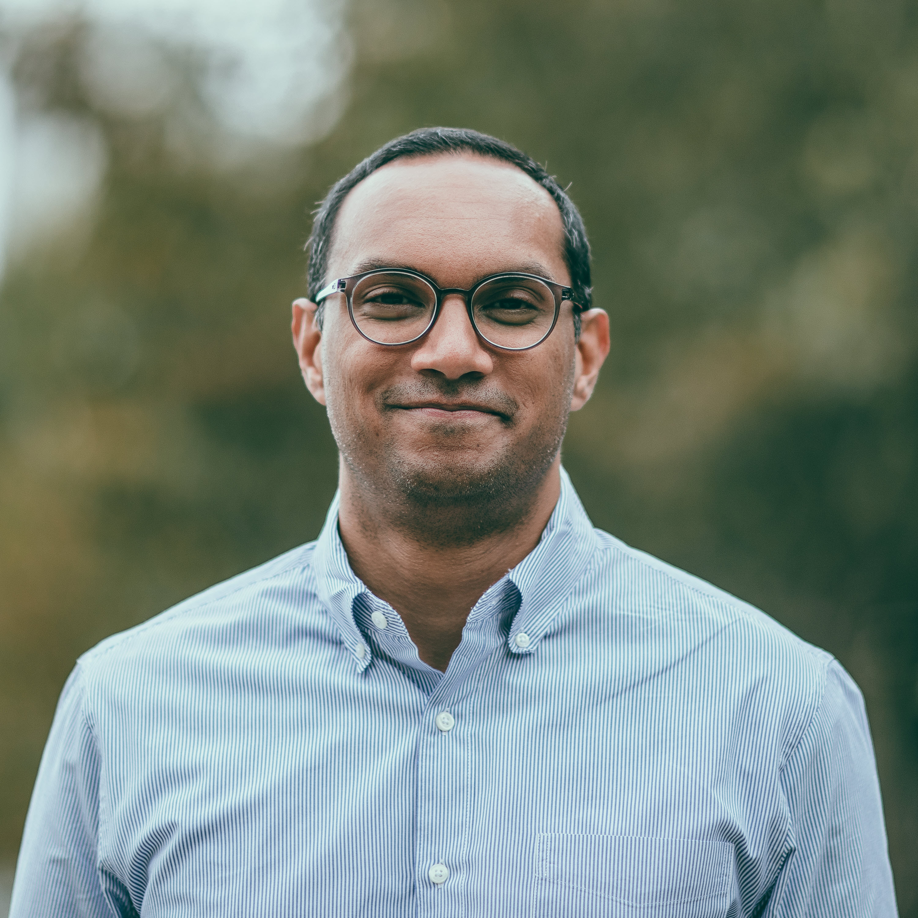 Profile image of Chaz Perera, the CEO and co-founder of Roots Automation.