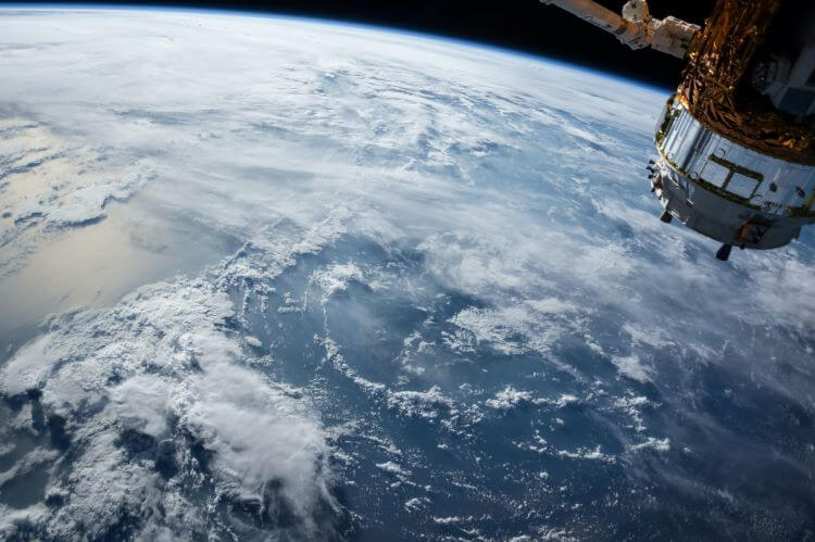 Image of weather patterns and heavy clouds from space.