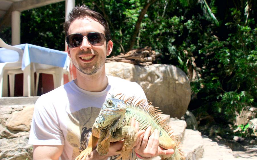 Team member with iguana