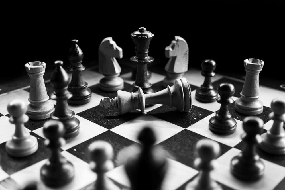 Black and white image of a finished game of chess.