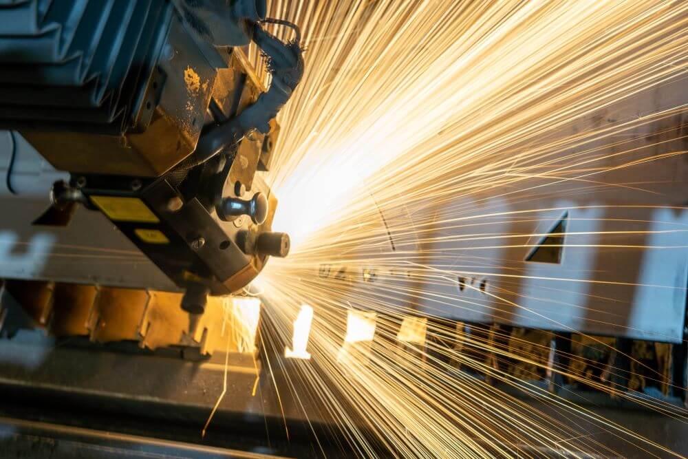 Image of a machine welding metal. Photo courtesy of Clayton Cardinalli via Unsplash.
