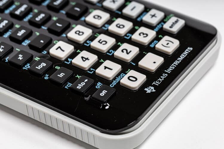 Image of a calculator against a white piece of paper.