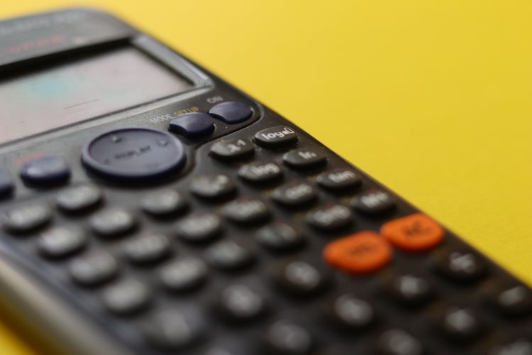 Image of an accounting calculator against a yellow background.