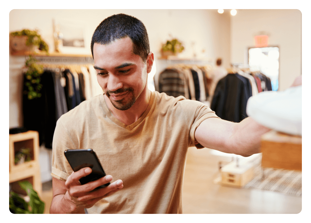 Man on phone while shopping