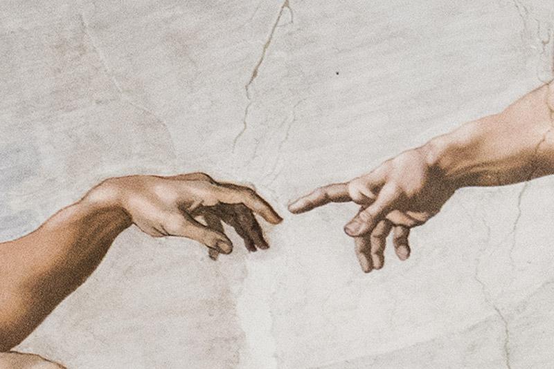 Détail du plafond de la chapelle Sixtine de l'homme qui tend son doigt vers dieu
