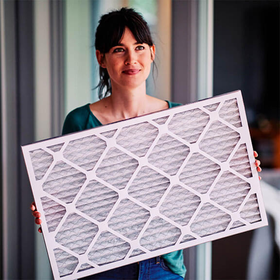 woman holding second nature air filter