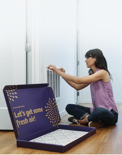 woman installing second nature air filter