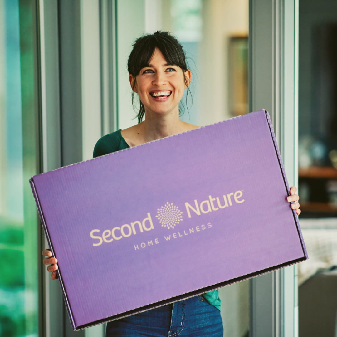 woman with second nature box