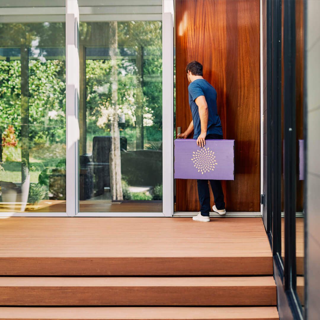 man taking second nature air filter off porch