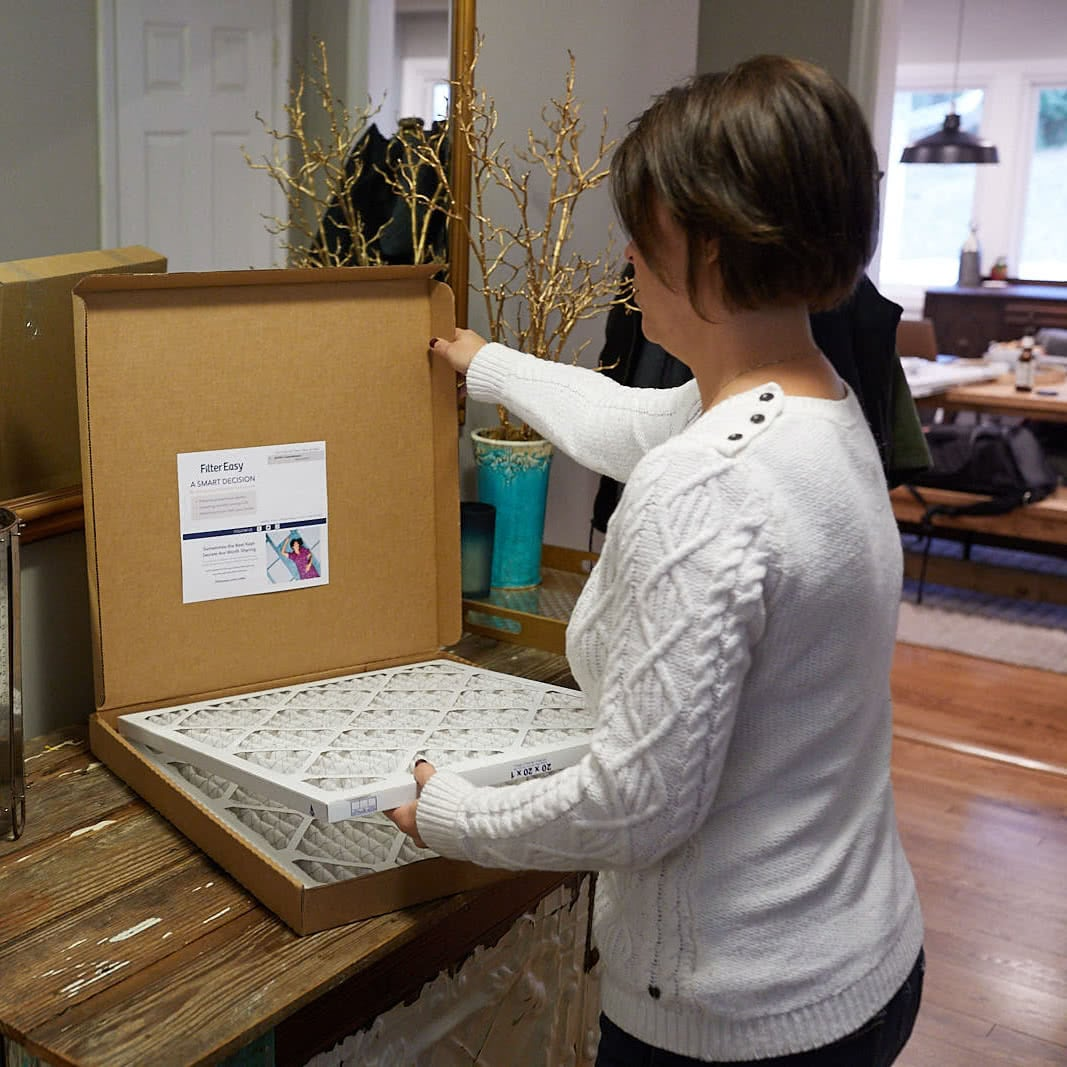 Woman opening second nature filter box