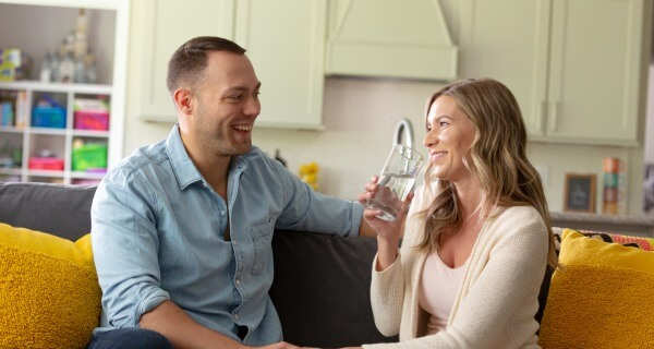 couple drinks clean water on the couch