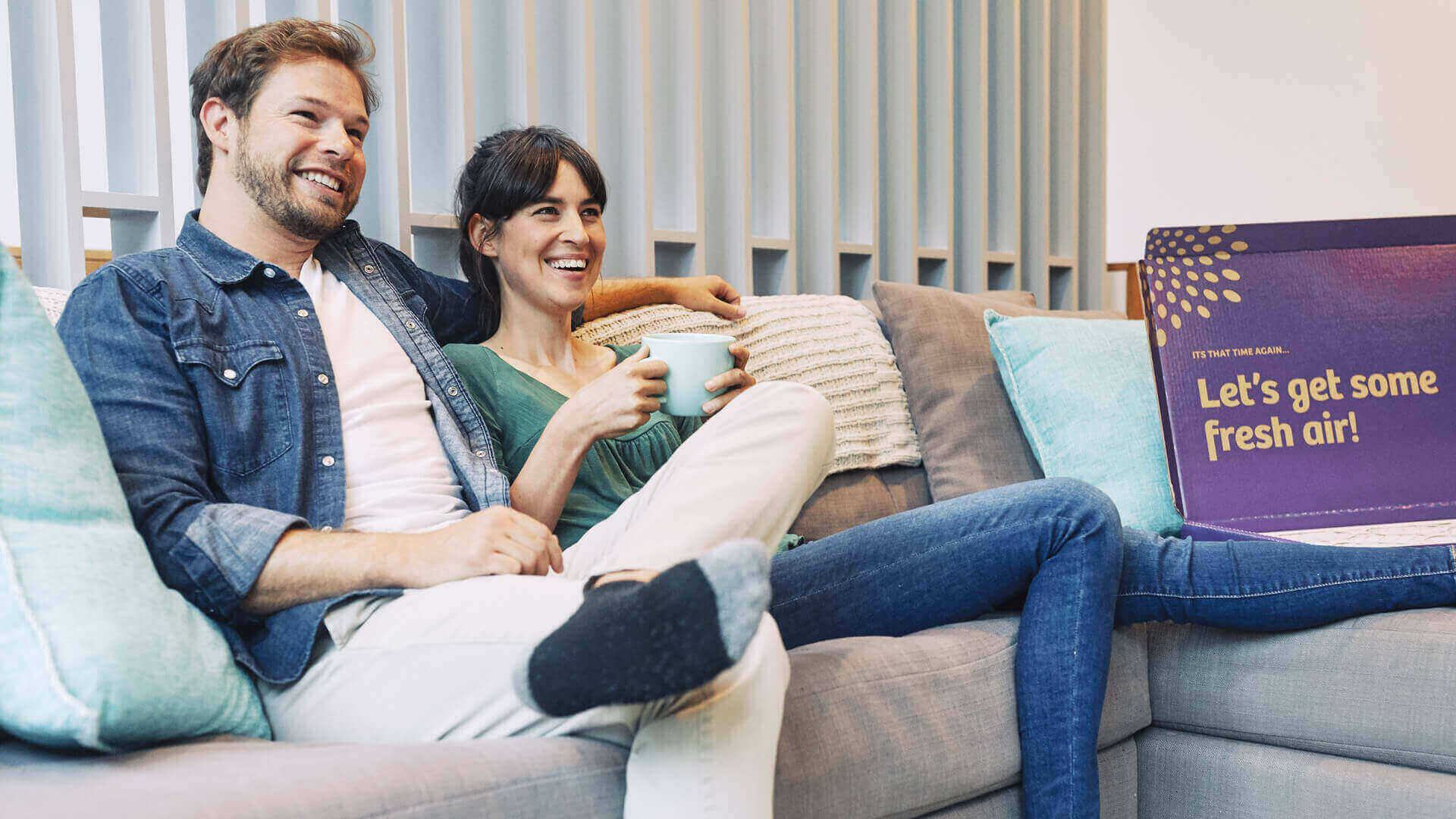 couple on couch with Second Nature box nearby