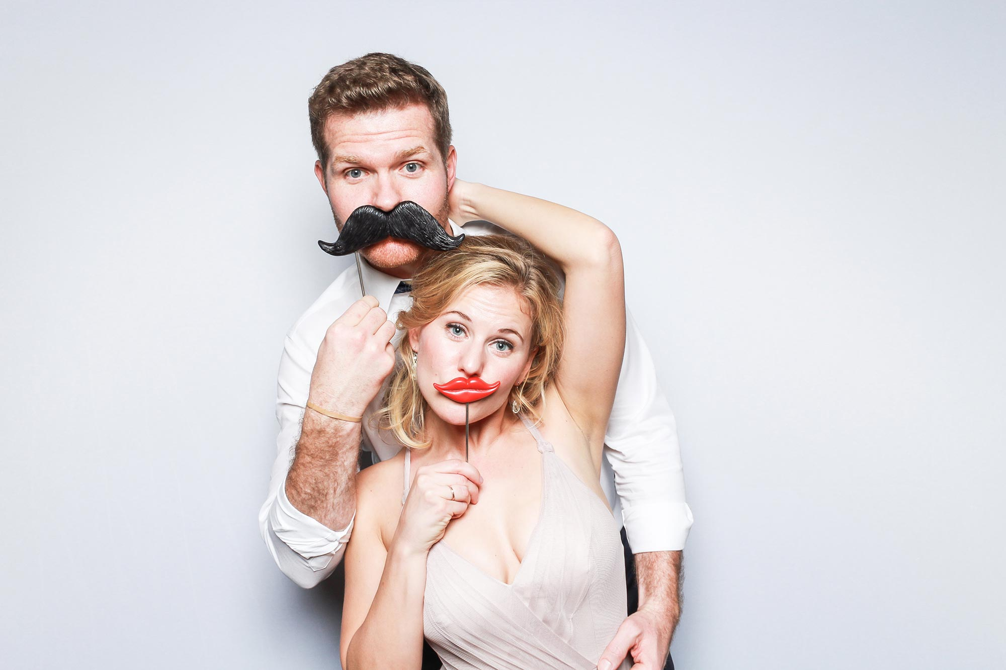 Fake mustache photo booth pose