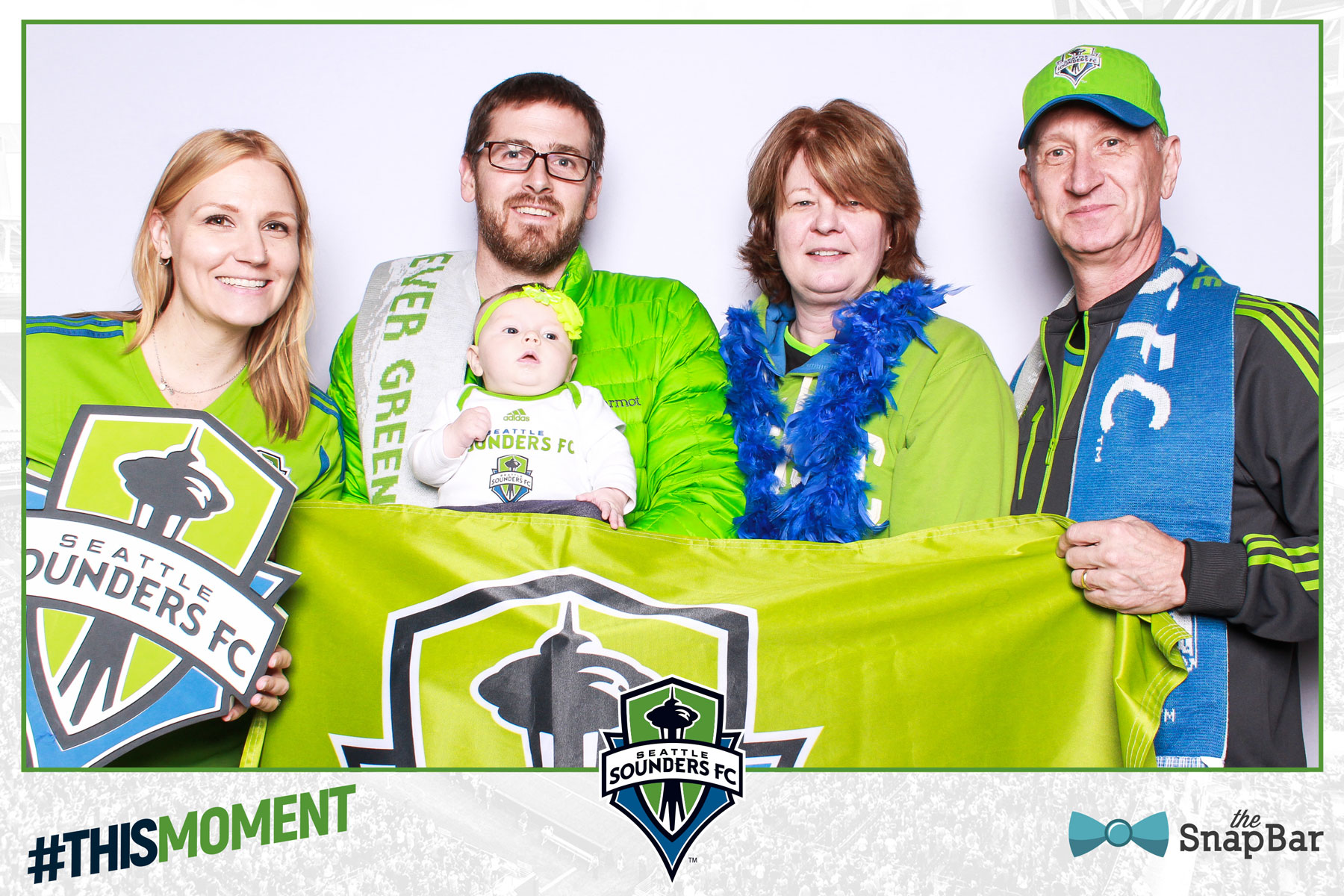 Baby in photo booth Sounders