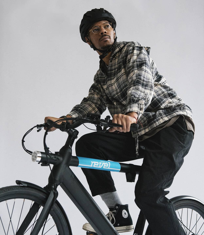 man riding revel ebike