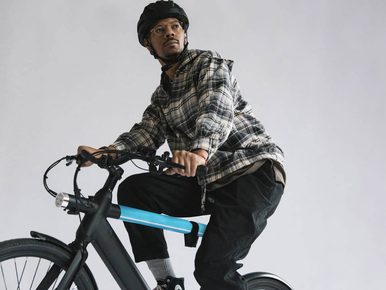 man riding revel ebike