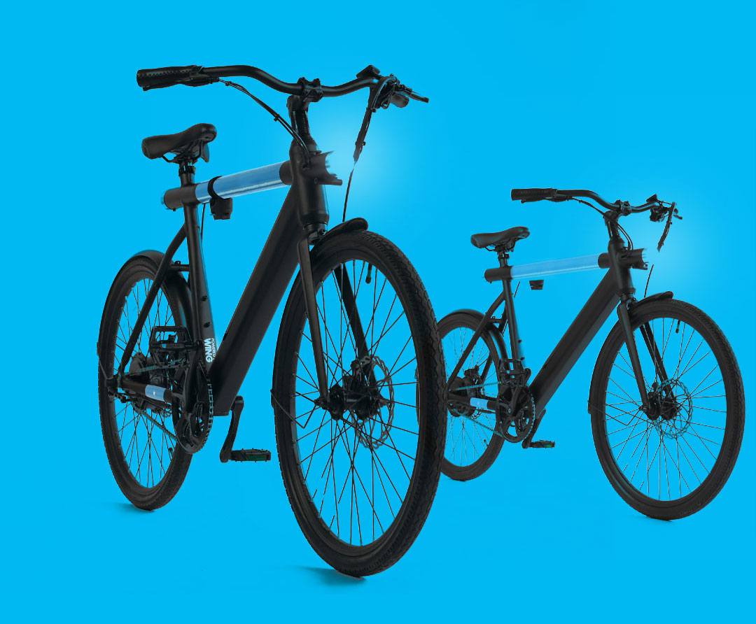 2 revel ebikes on blue background