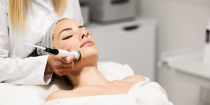 Woman getting facial treatment at Beverly Hills Rejuvenation Center