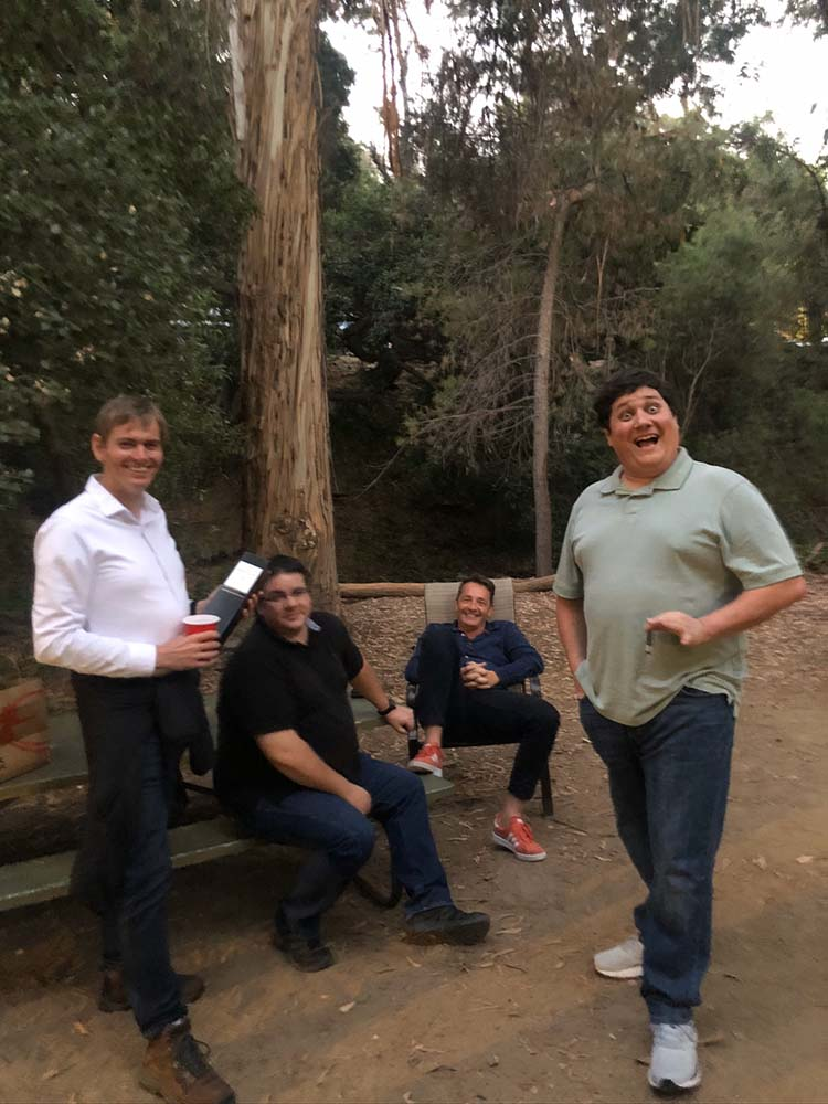 Team members hanging out in the forest
