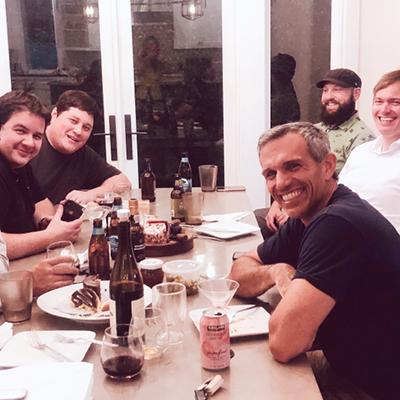 Team members having dinner together
