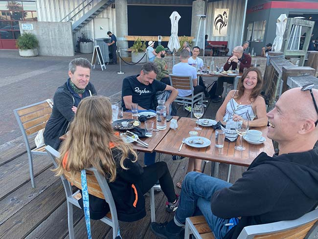 Team members enjoying dinner on a patio