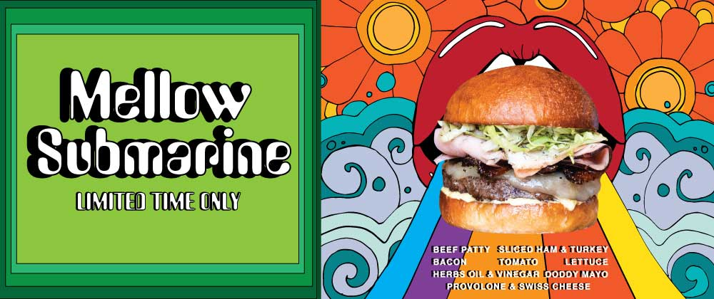 Mellow Submarine. Limited Time Only. Certified Piedmontese Beef Patty topped with sliced ham & turkey, provolone & swiss cheese, bacon, LTO, oil & vinegar, doddy mayo and herbs, sliced onion.