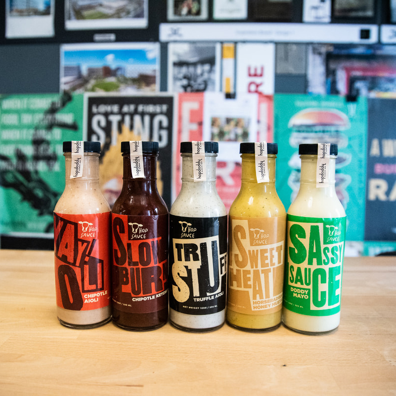 Lineup of signature Hopdoddy sauces to-go.