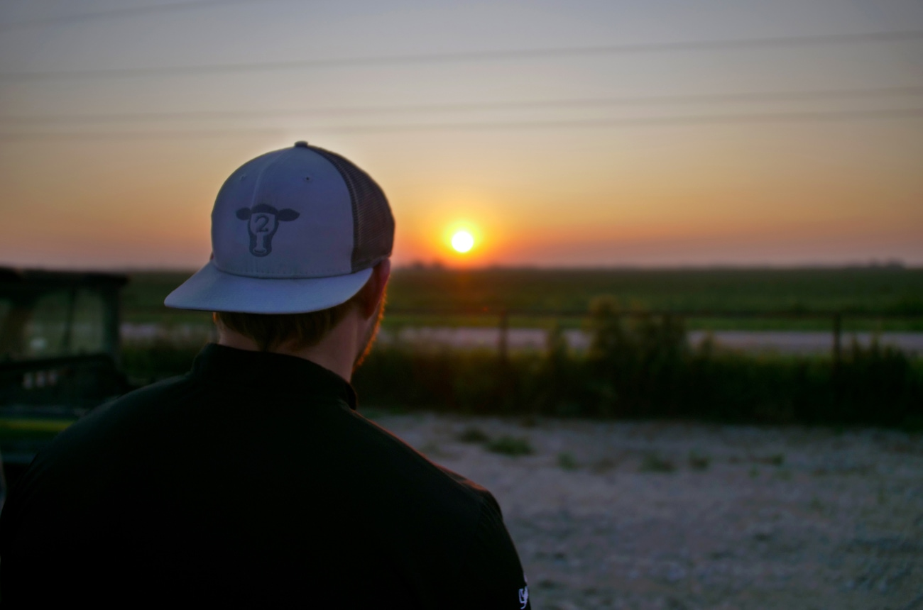 Man in Hopdoddy hat at sunset.