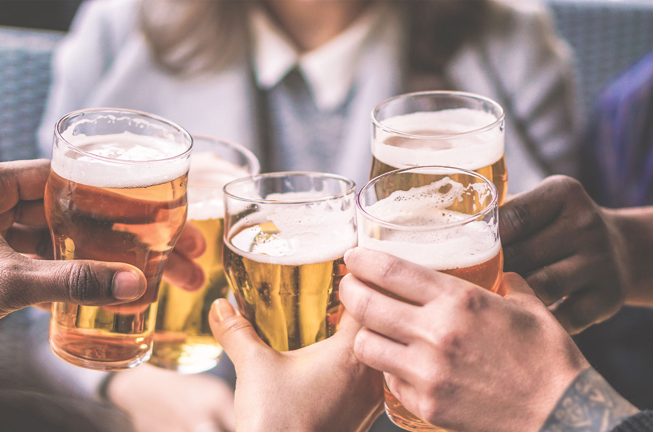 5 people cheers glasses of beer.