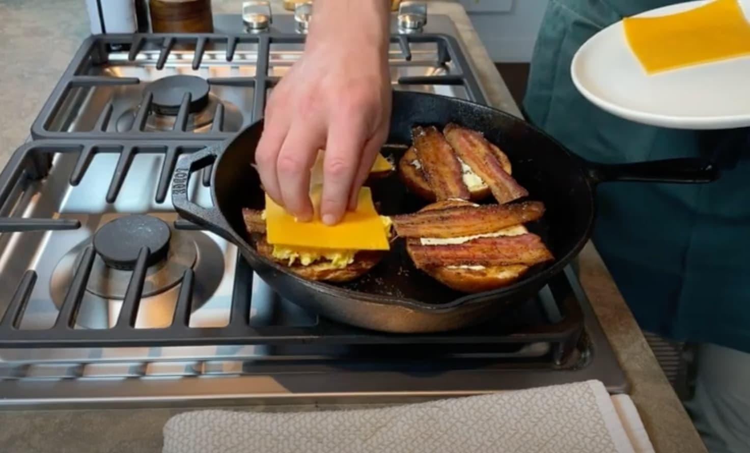 Cooking a breakfast sandwich.