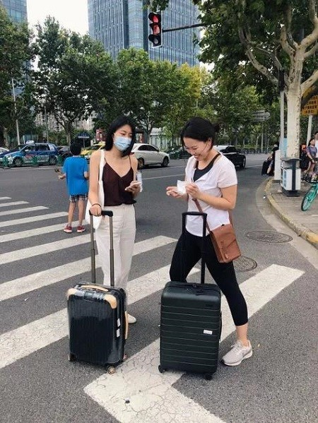 J and L with their suitcases