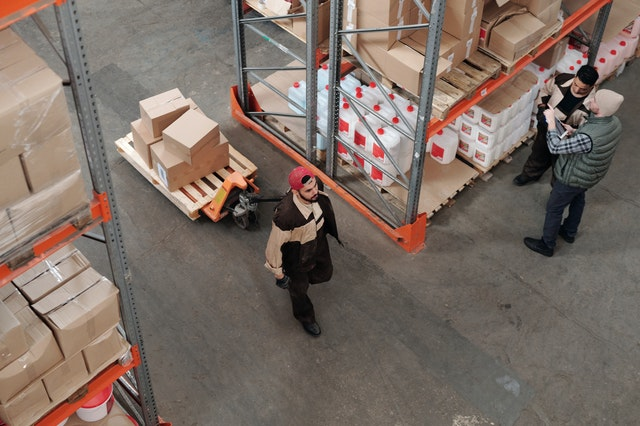 man moving warehouse inventory