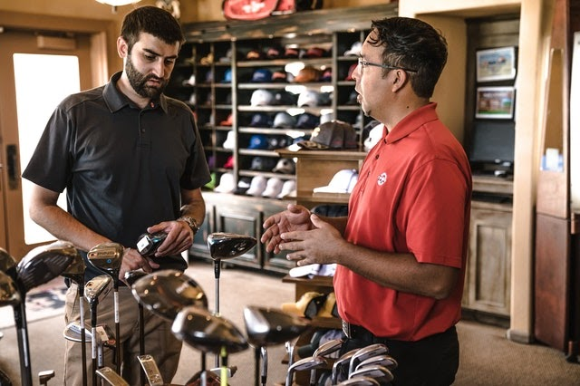 man shopping for golf clubs